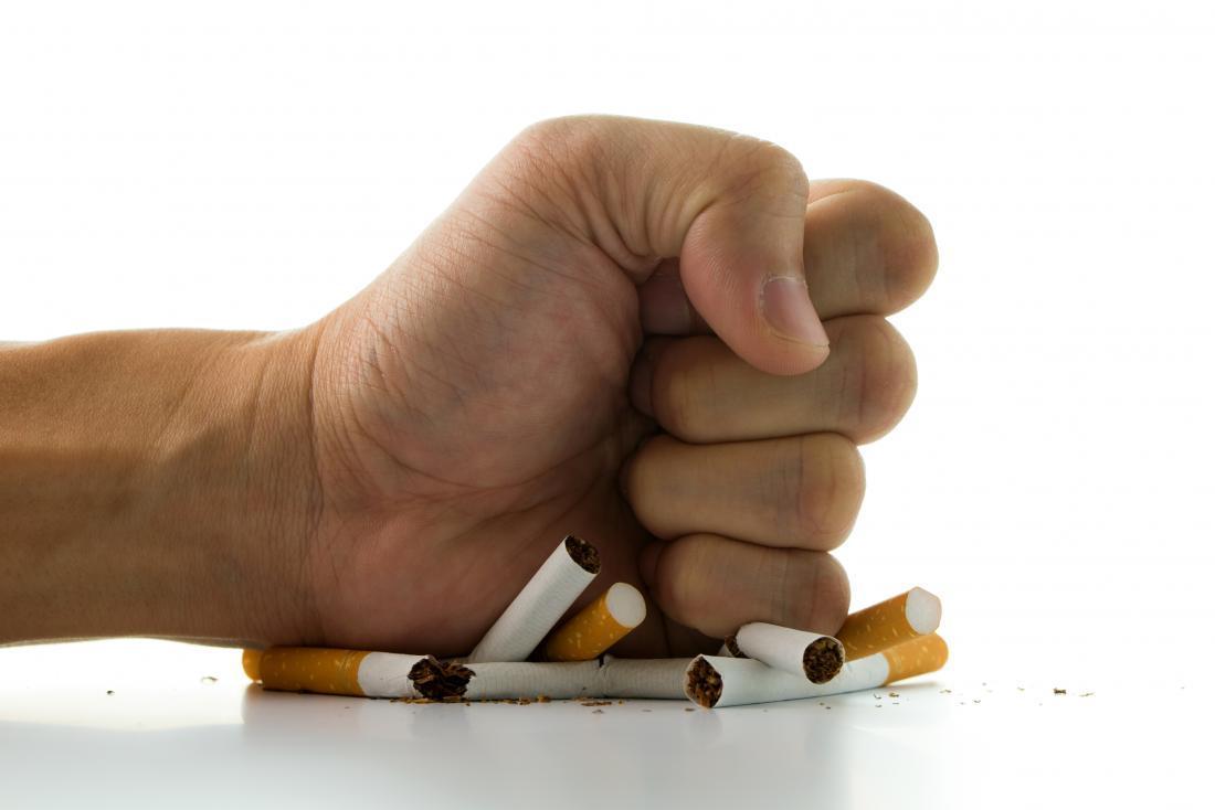 hand crushing cigarrettes