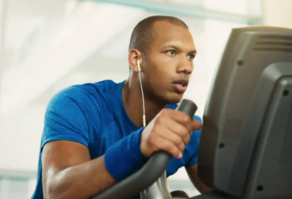 man with headphones while training